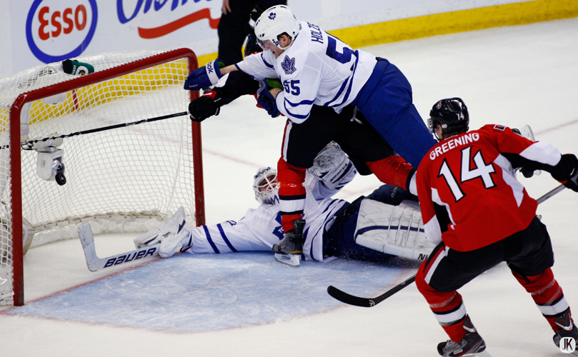 OTTAWA, CANADA - FEBRUARY 23, 2013: Ottawa score during a goal crease scramble  during an NHL game between the Maple Leafs and Ottawa Senators at Scotiabank Place in Ottawa, Ontario, Canada. ***** Editorial Use Only *****Jay Kopinski/Icon SMI