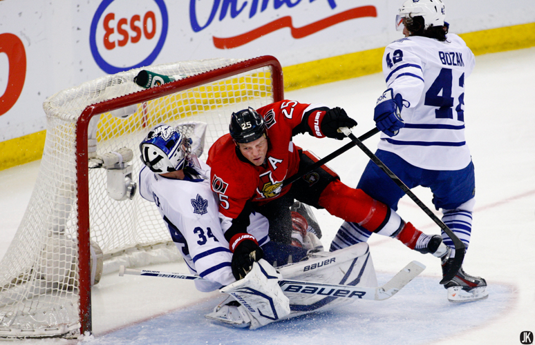OTTAWA, CANADA - April 20, 2013: James Reimer #34 gets run over by Chris Neil #25 during an NHL game between the Maple Leafs and Senators at Scotiabank Place in Ottawa, Ontario, Canada. *****  Editorial Use Only *****Jay Kopinski Icon/Smi