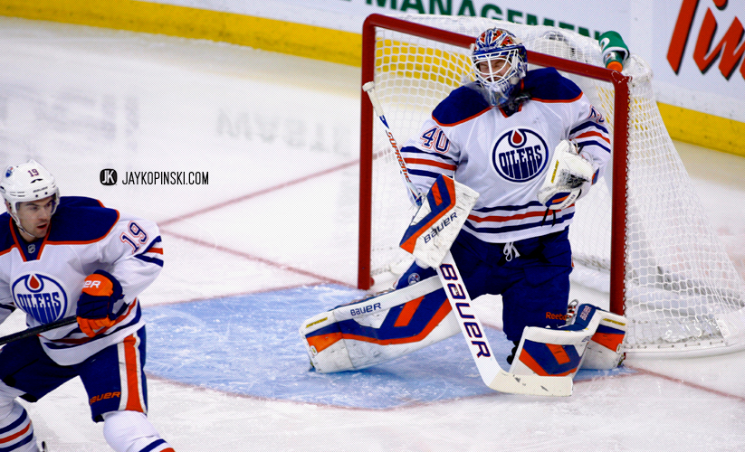 OTTAWA, CANADA - October 19: Devan Dubnyk #40 with a shot off the mask during a game between the Oilers and Senators at Canadian Tire Centre on October 19, 2013 in Ottawa, Ontario, Canada. ***** Editorial Use Only *****Jay Kopinski - Icon SMI
