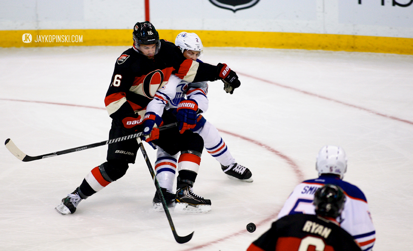 OTTAWA, CANADA - October 19: Clarke Macarthur #16 tries to get past Jeff Petry #2 during a game between the Oilers and Senators at Canadian Tire Centre on October 19, 2013 in Ottawa, Ontario, Canada. ***** Editorial Use Only *****Jay Kopinski - Icon SMI