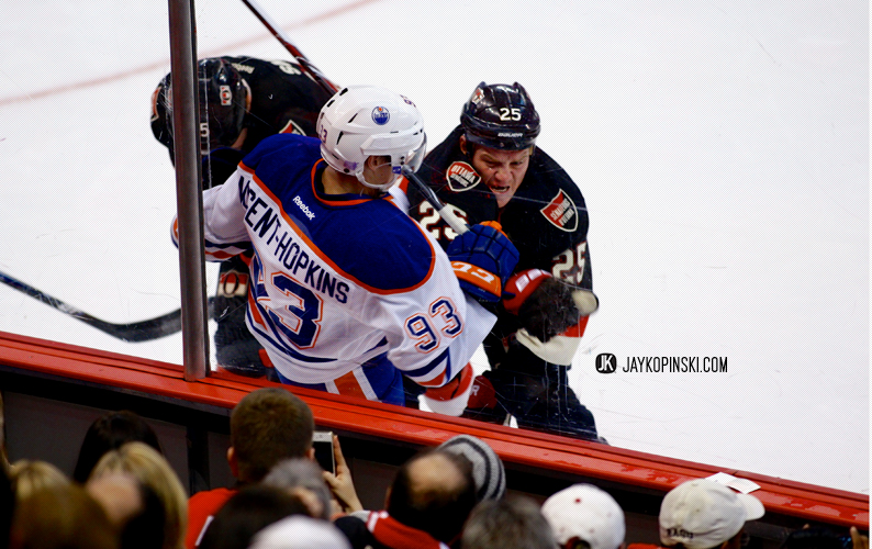 "OTTAWA, CANADA - October 19: Chris Neil #25 ""A"" with a hit on Ryan Nugent-Hopkins #93 during a game between the Oilers and Senators at Canadian Tire Centre on October 19, 2013 in Ottawa, Ontario, Canada. ***** Editorial Use Only *****Jay Kopinski - Icon SMI"